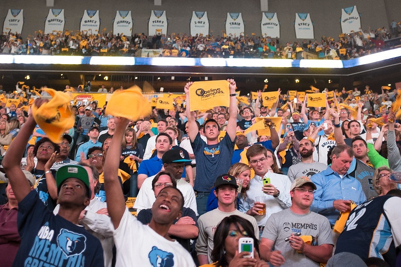 Photo of basketball fans cheering during a Memphis Grizzlies game at FedexForum.