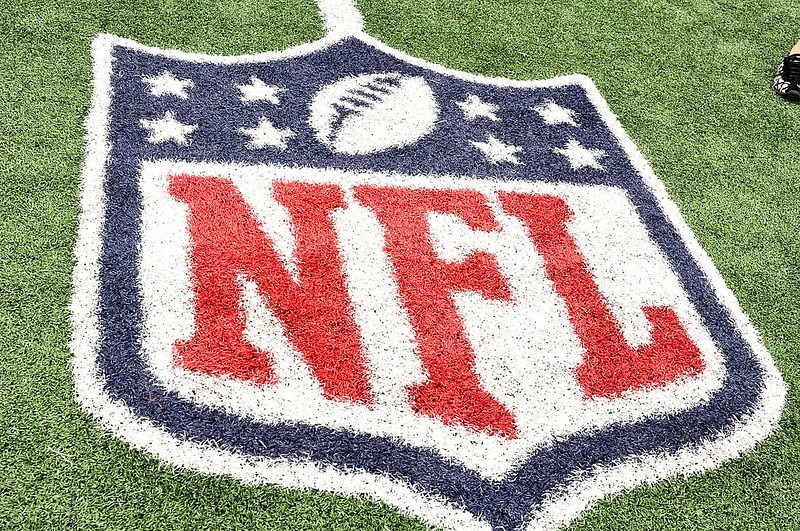 Photo of the NFL logo painted on a football field.