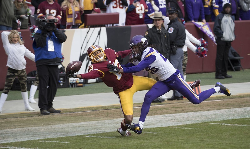 Photo of a touchdown catch in an NFL game between the Washington Redskins and Minnesota Vikings.