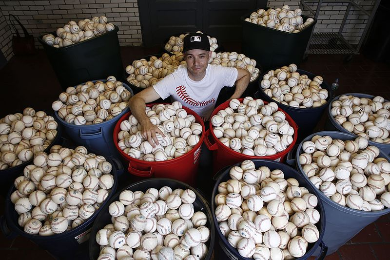 Photo of Zack Hample with his baseball collection.